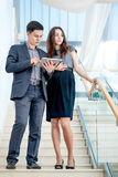 A young man and young woman standing on the stairs  Royalty Free Stock Photo