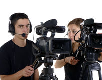 Young man and young woman with video cameras Royalty Free Stock Image