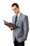 Young manager. Young businessman standing with his portfolio Stock Photography