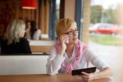 Young manager call by phone look away Stock Images