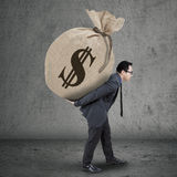 Young manager carrying money bag Royalty Free Stock Photos