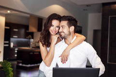 Young manager couple communicating online by laptop Stock Photography