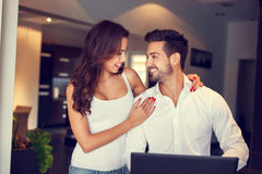 Young manager couple communicating online by laptop indoor Stock Photo