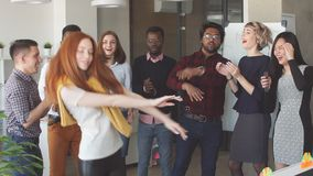 Young Manager girl in a stylish outfit entertains her colleagues. stock video footage