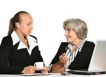 Young manager and her elderly collegue Royalty Free Stock Photography