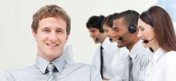Young manager with his team in a call center Royalty Free Stock Photos
