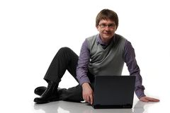 Young manager with laptop Royalty Free Stock Photography