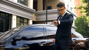 Young manager late for dinner with clients, traffic jams in city time management stock photos