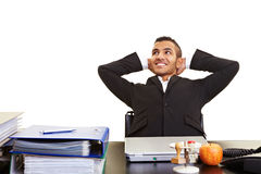 Young manager leaning back Royalty Free Stock Image