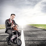 Young manager play a guitar Royalty Free Stock Photography
