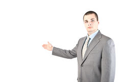 Young manager presenting something isolated on whi Royalty Free Stock Image
