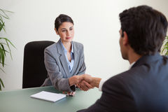 Young manager shaking the hand of a customer Royalty Free Stock Image