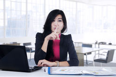 Young manager showing silent sign Stock Photos