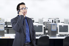 Young manager talking on the phone in office Stock Photography