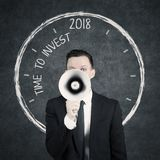 Young manager with text of time for invest Royalty Free Stock Photo