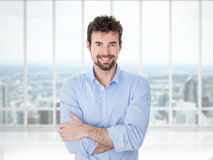 Young manager on a top of a skyscraper Stock Photos