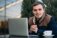 The young manager working on a laptop in the park. Lunch Break. Bank Royalty Free Stock Photography