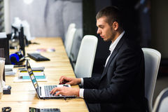 Young manager at the workplace. Young man working on computer in office Royalty Free Stock Photos