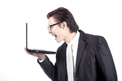 Young Manager Yelling at His laptop. Asian businessman angry isolated on white Stock Images