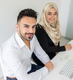 Young mand and woman working in office Royalty Free Stock Image