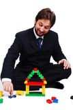 Young mane wearing suit is making a house Royalty Free Stock Images