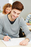 Mann taking exam in university Royalty Free Stock Photography