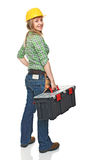 Young manual worker. Standing woman manual worker with toolbox isolated on white background Stock Photo