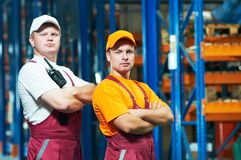 Young manual workers in warehouse Stock Image