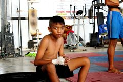 Young Mao Thai boxer in the training class stock image