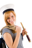 Young marine woman with spyglass in sailor hat Royalty Free Stock Photo