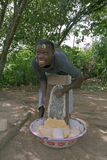 Village life, woman grating manioc, Surinam royalty free stock images