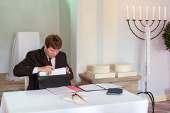 Marriage celebrant preparing documents for wedding Royalty Free Stock Image