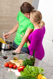 Young marriage in kitchen Royalty Free Stock Images