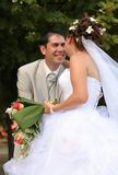 Young married couple. Posing in the wedding day Royalty Free Stock Photos