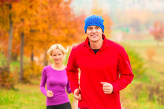 Young married couple athletes on the jog Stock Photo