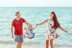 Family with child by the sea stock photo