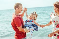 Family with child by the sea royalty free stock photos