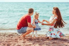 Family with child by the sea stock photography