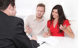 Young married couple at desk in a business meeting Stock Images