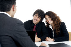 Young married couple at desk in a business meeting Royalty Free Stock Images