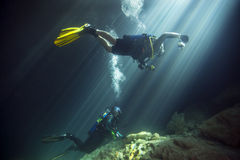 Young Married Couple - Diving Devils Den. A young married couple celebrate their ten year anniversary by SCUBA diving in clear freshwaters of Devils Den Springs stock images