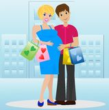 Young married couple in expectant of child with purchase Royalty Free Stock Photo
