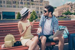 Young married couple got lost on vacation in town. Frustrated lady is arguing with her boyfriend, who holds pda, has no idea where stock images