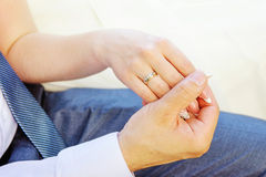 Young married couple holding hands Royalty Free Stock Photography