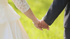 Young married couple holding hands, ceremony wedding day stock video