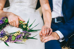 Young married couple holding hands. Ceremony wedding day Stock Images