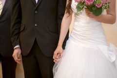 Young married couple holding hands, ceremony at wedding day. The Young married couple holding hands, ceremony at wedding day Stock Photography