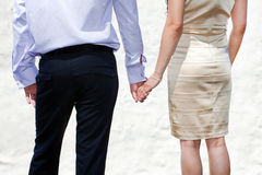 Young married couple holding hands Royalty Free Stock Photo