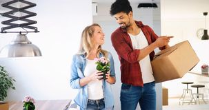 Young couple Moving in new home and unpacking carboard boxes. Young married couple Moving in new home and unpacking carboard boxes Stock Image