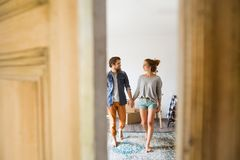 Couple moving in new house, entering through the door. Stock Photography